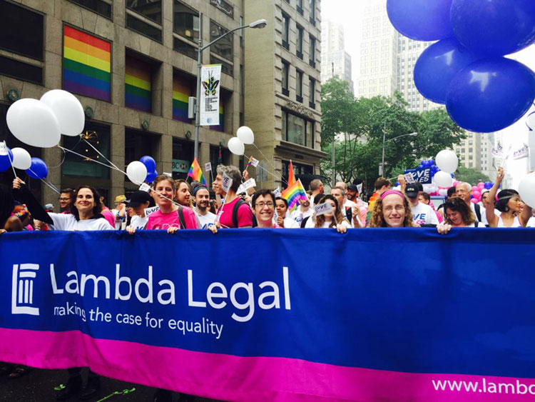 KU Law student Jessica Frederick and fellow interns hold the Lambda Legal banner during NYC's PrideFest parade