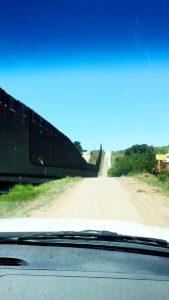 Wall and road at the Arizona-Mexico border