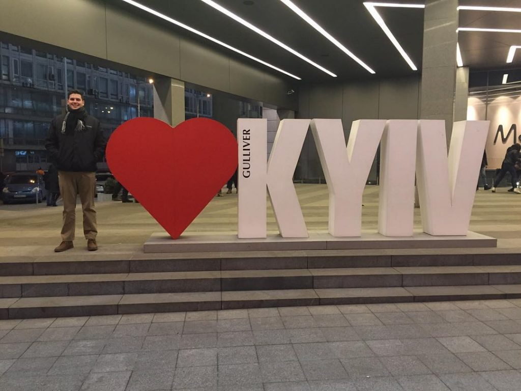 "Josh DeMoss with ""I Heart Kyiv"" sign."