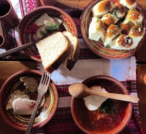 Bowls of Ukranian dishes and bread.