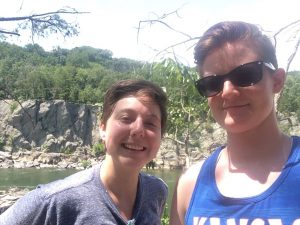 Malone and her girlfriend, Rachel Bunner, in front of trees and rock outcroppings.