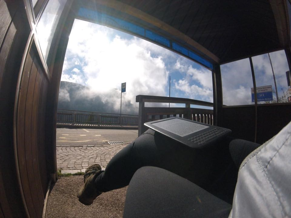 Bus stop with mountain views and clouds