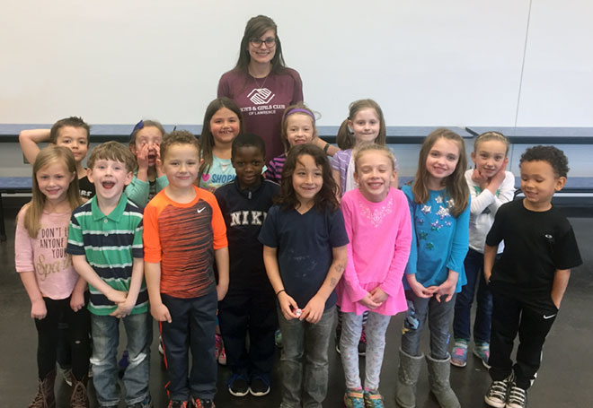 Sophia Dinkel with children at Boys & Girls Club of Lawrence.