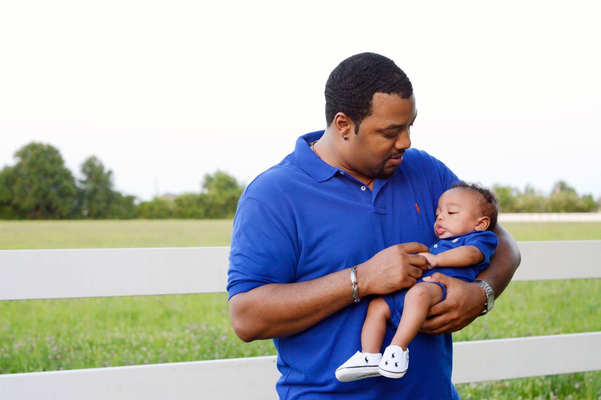 Kriston Guillot and his infant son, Kai.