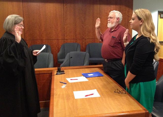 Katie Gilman, being sworn in as a CASA volunteer
