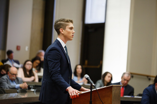 TJ Blake presents an argument in the KU Law courtroom
