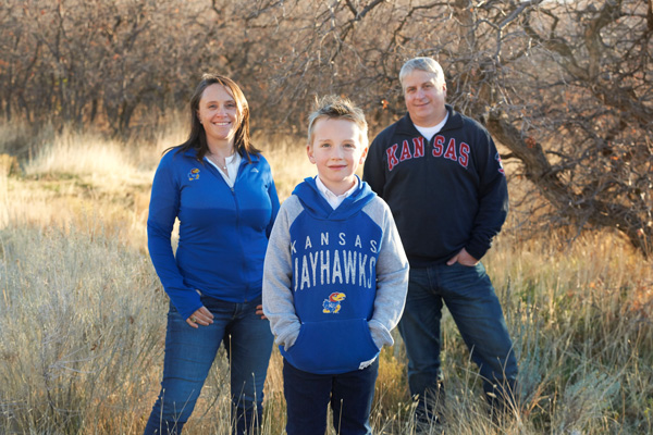 The Stowell family poses in KU gear