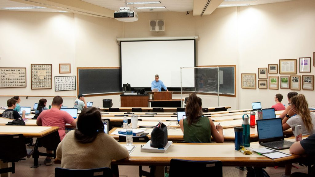 Bar preparation instructor Glenn Jewell reads instructions to students during a simulated bar exam.