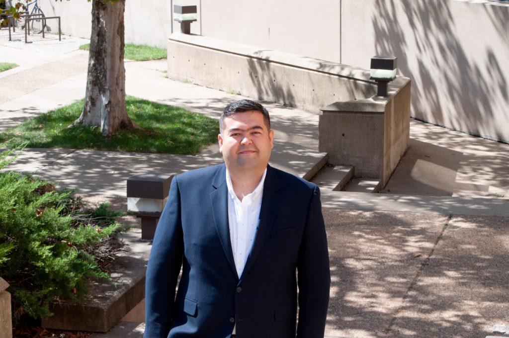Sardorbek Yusupov standing outside Green Hall
